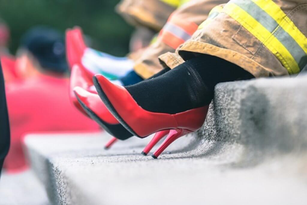 walk a mile event image of fireman wearing red heels